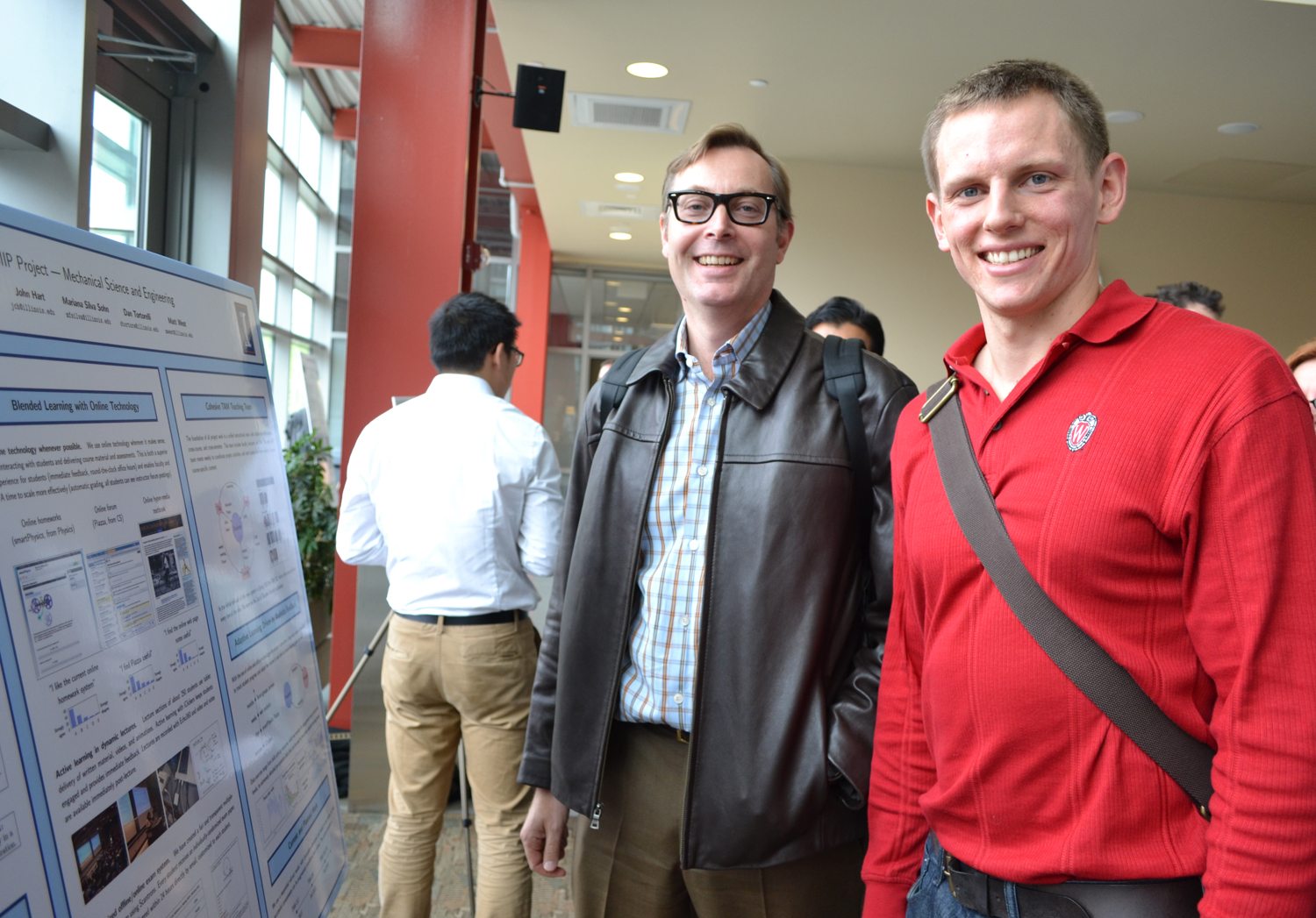 MechSE Professor Geir Dullerud and grad student Aaron Anderson from the TAM SIIP team.