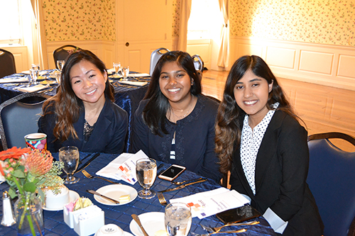 Left to right: Fundraising Committee director Vera Liu, SWE member Isha Tyle, and Outreach Committee Co-chair Simran Vinaik prepare to enjoy the evening at SWE's recent Be Professional event.