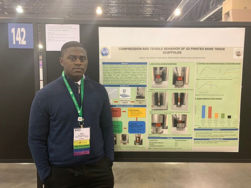 Tarik Simpson  presents a poster about his research during the BMES (Biomedical Engineering Society annual meeting in Philadelphia in 2019. (Image courtesy of Tarik Simpson.)