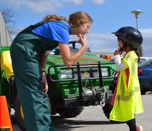 Vet Med student interacts with young visitor to the Large Animal Emergency Rescue station at the Vet Med Open House.