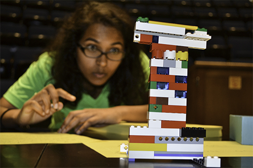 During the 2015 WIE Orientation, an Engineering freshman competes in a Lego team-building activity.