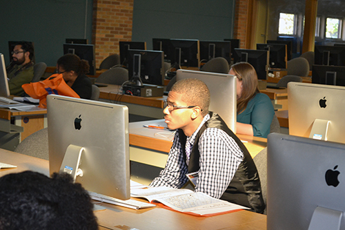 An undergraduate student pays close attention during Daniel Wong's workshop on how to apply to graduate school.