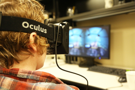A student using Occulus equipment in the AVL.