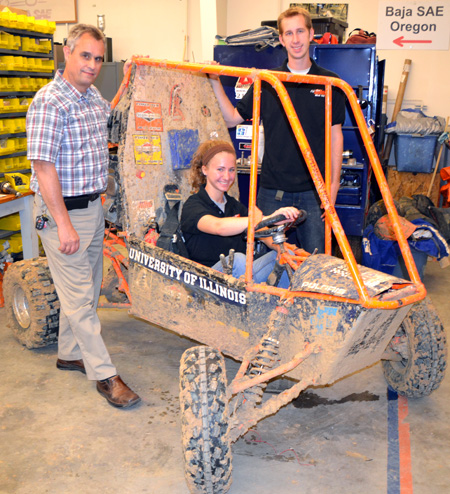 Mike Philpott with students Katherine Birkel and Paul Hummon show off Baja's fresh coat of Illinois mud from this past weekend.