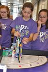 Members of the P cubed team work on their lego robot at the FIRST Lego Champtionship.