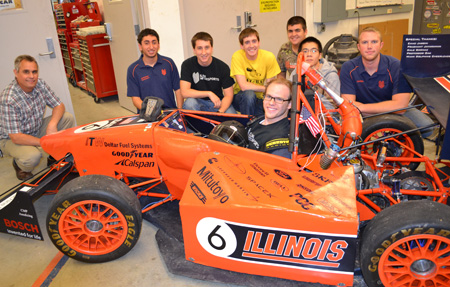 Mike Philpott (left) and members of the Formula SAE team pose with last year's Formula vehicle.