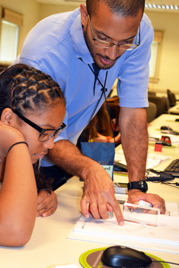 GLEE camp director, Lynford Goddard, instructs a camper during the Optics session.