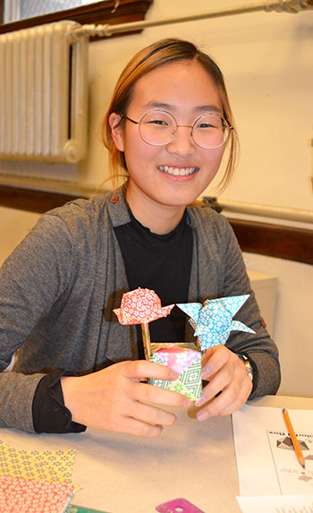 A GEMS participant shows off her origami creations.