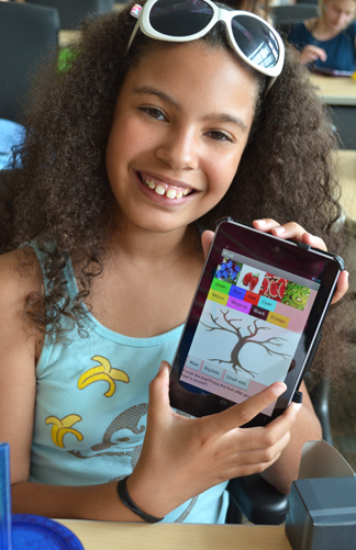 GEMS camper proudly displays the Android app she created.