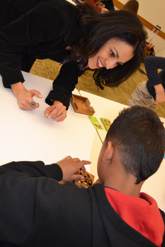 Rochelle Gutiérrez interacts with middle school student at the Noyce iMath club.