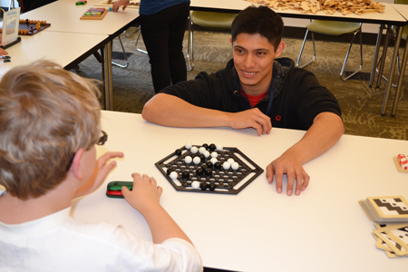 Emmanuel Del Rio, a junior in math at Illinois, plays a math game with a local student.