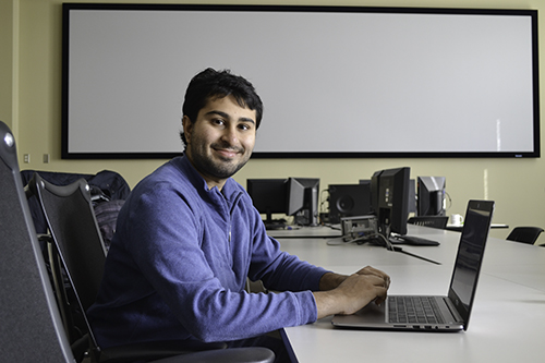 SPIN student Sujay Shah at work in the SPIN office in NCSA. Also mentored by Dr. Andre Schleife, Shah is working on the virtual reality aspect of a project about data vizualization for Schleife's Material Science course.